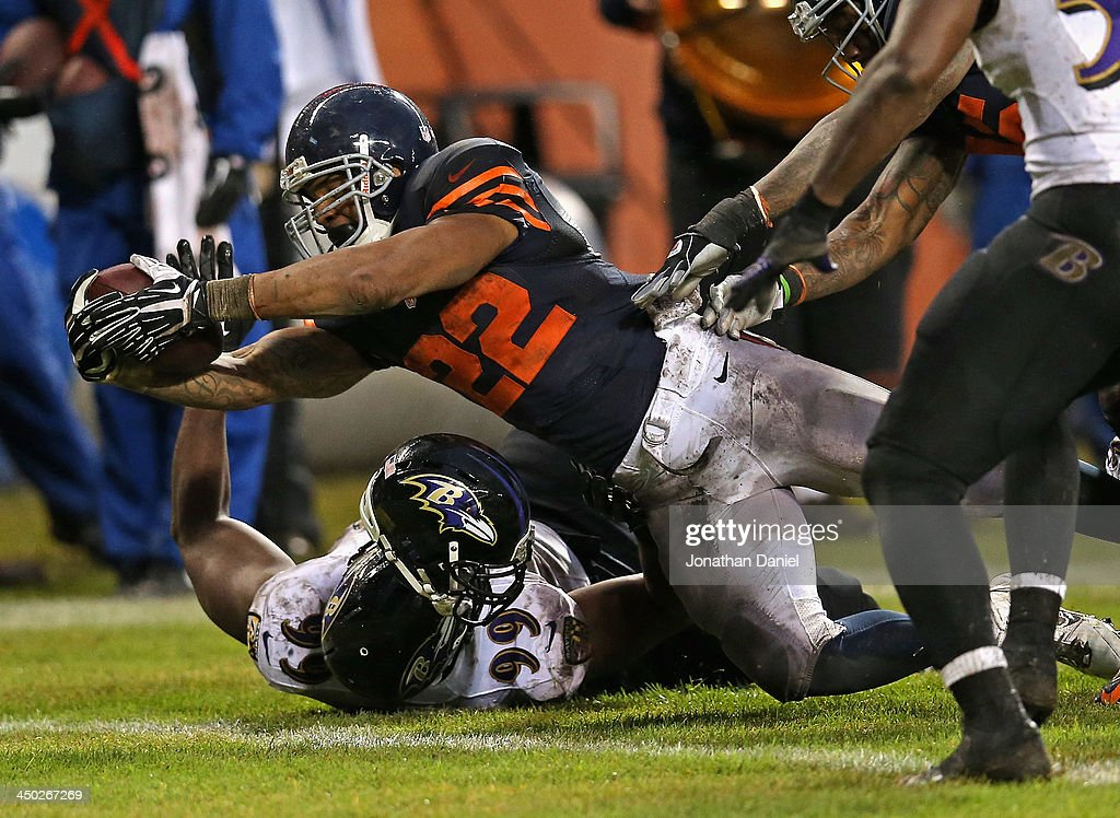 <a gi-track='captionPersonalityLinkClicked' href=/galleries/search?phrase=Matt+Forte&family=editorial&specificpeople=2246847 ng-click='$event.stopPropagation()'>Matt Forte</a> #22 of the Chicago Bears dives over Chris Canty #99 of the Baltimore Ravens to score a touchdown at Soldier Field on November 17, 2013 in Chicago, Illinois. The Bears defeated the Ravens 23-20 in overtime.