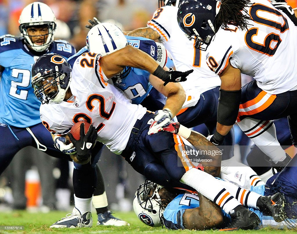 <a gi-track='captionPersonalityLinkClicked' href=/galleries/search?phrase=Matt+Forte&family=editorial&specificpeople=2246847 ng-click='$event.stopPropagation()'>Matt Forte</a> #22 of the Chicago Bears drives up the middle of the Tennessee Titans defense during a preseason game at LP Field on August 27, 2011 in Nashville, Tennessee.