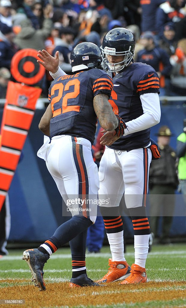 Matt Forte #22 of the Chicago Bears is congratulated by Jay Cutler #6 after scoring a touchdown against the Carolina Panthers on October 28, 2012 at Soldier Field in Chicago, Illinois.