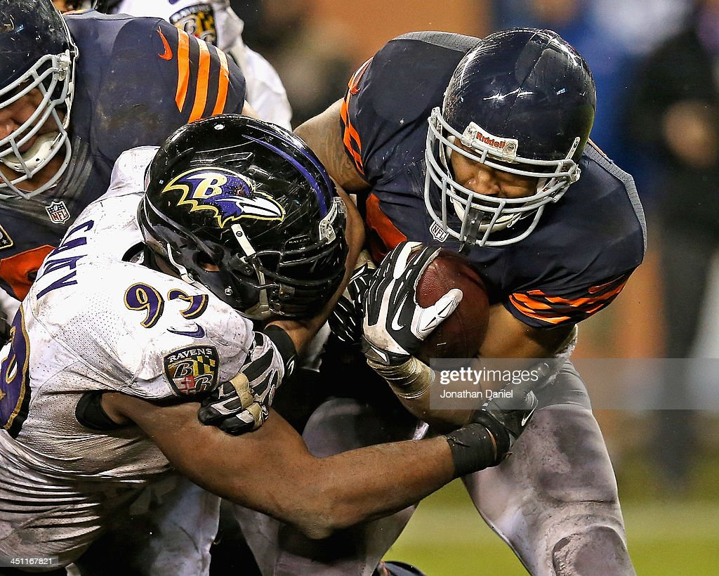 Matt Forte #22 of the Chicago Bears is hit by Chris Canty #99 of the Baltimore Ravens at Soldier Field on November 17, 2013 in Chicago, Illinois. The Bears defeated the Ravens 23-20 in overtime.