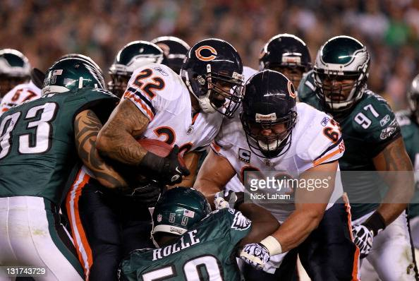 Matt Forte of the Chicago Bears is tackled by Jason Babin and Brian Rolle of the Philadelphia Eagles during the first quarter of the game at Lincoln...