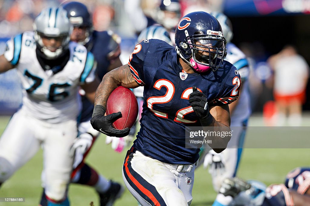 Matt Forte #22 of the Chicago Bears runs the ball against the Carolina Panthers at the Soldier Field on October 2, 2011 in Chicago, Illinois. The Bears defeated the Panthers 34 to 29.