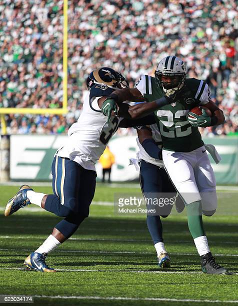 Matt Forte of the New York Jets breaks a tackle against Maurice Alexander and EJ Gaines of the Los Angeles Rams in the second quarter at MetLife...