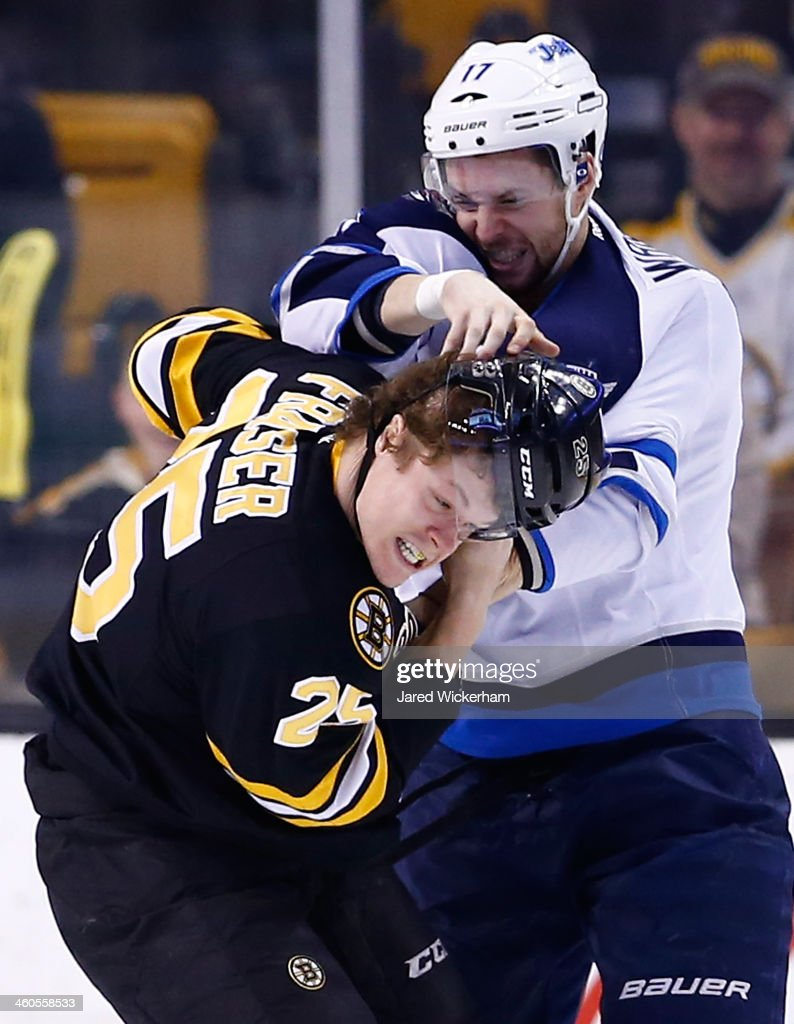 Matt Fraser #25 of the Boston Bruins fights James Wright #17 of the Winnipeg Jets in the first period during the game at TD Garden on January 4, 2014 in Boston, Massachusetts.