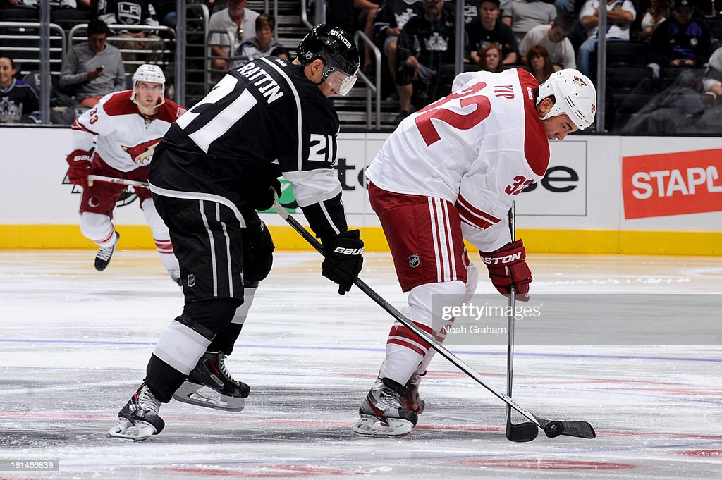 Matt Frattin of the Los Angeles Kings battles for the puck against Brandon Yip of the Phoenix Coyotes at Staples Center on September 15 2013 in Los...