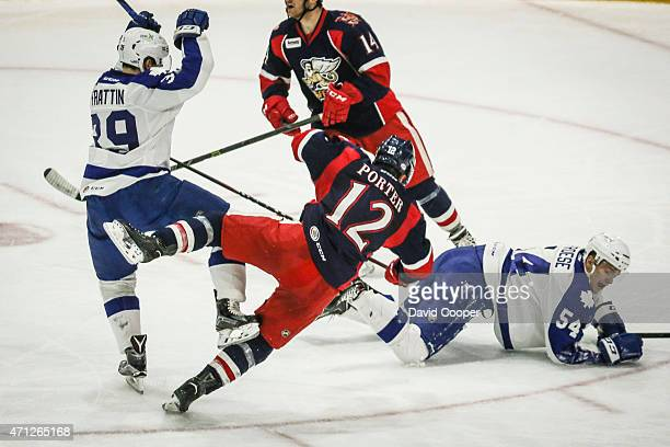 TORONTO ON APRIL 26 Matt Frattin of the Marlies takes out Kevin Porter of the Griffins during the second game of the AHL playoffs for the Calder Cup...