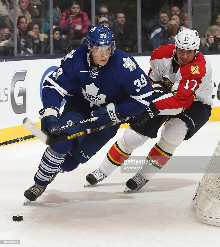Matt Frattin #39 of the Toronto Maple Leafs gets away from Filip Kuba #17 of the Florida Panthers during NHL action at the Air Canada Centre March 26, 2013 in Toronto, Ontario, Canada.