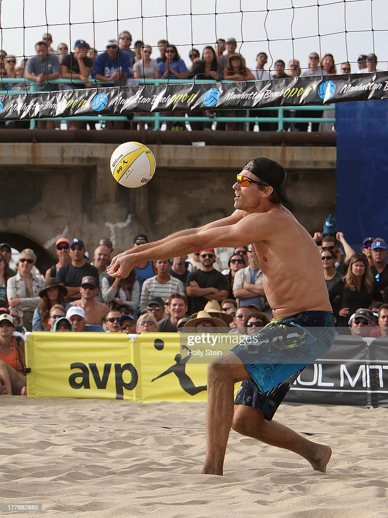 Matt Fuerbringer digs the ball during the men's finals at the AVP Manhattan Beach Open on August 25, 2013 in Manhattan Beach, California. Fuerbringer and his partner Casey Jennings defeated Sean Rosenthal and Phil Dalhausser 21-18, 21-23, 15-12. Photo by Holly Stein/Getty Images)