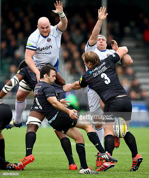 Matt Garvey and Henry Thomas of Bath try to block a kick by Neil De Kock of Saracens during the Aviva Premiership match between Saracens and Bath...