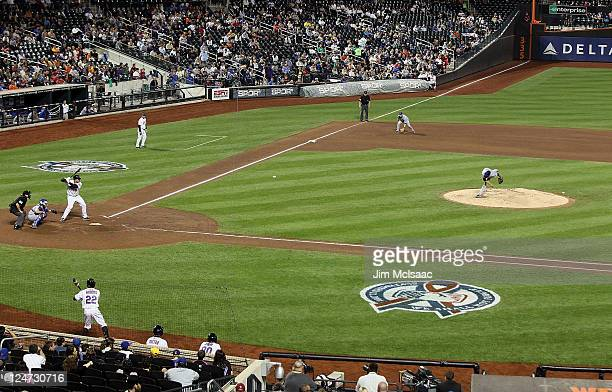 Matt Garza of the Chicago Cubs pitches to Ronny Paulino of the New York Mets at Citi Field on September 11 2011 in the Flushing neighborhood of the...