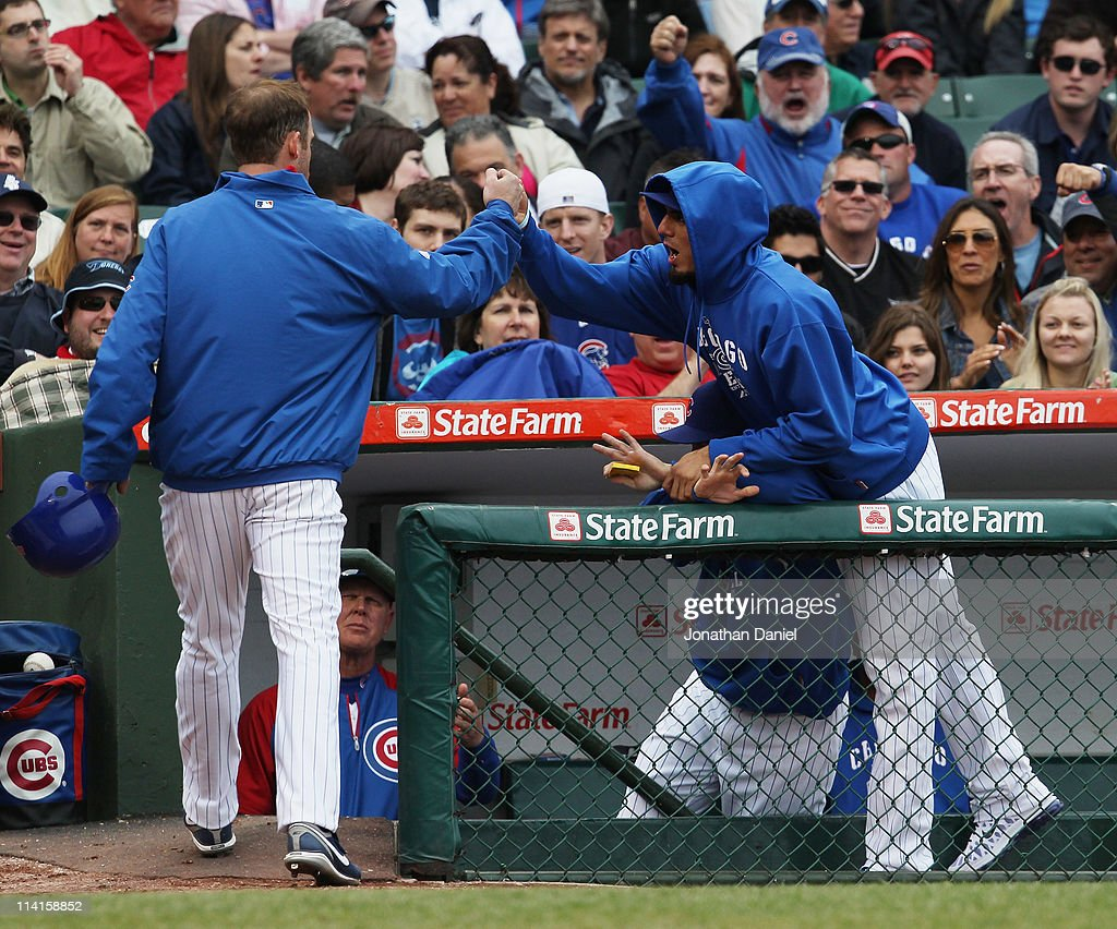 <a gi-track='captionPersonalityLinkClicked' href=/galleries/search?phrase=Matt+Garza&family=editorial&specificpeople=835829 ng-click='$event.stopPropagation()'>Matt Garza</a> #17 of the Chicago Cubs (R) playfully jumps over a teammate to congratulate <a gi-track='captionPersonalityLinkClicked' href=/galleries/search?phrase=Ryan+Dempster&family=editorial&specificpeople=211606 ng-click='$event.stopPropagation()'>Ryan Dempster</a> #46 after Demster scored a run against the San Francisco Giants at Wrigley Field on May 13, 2011 in Chicago, Illinois.