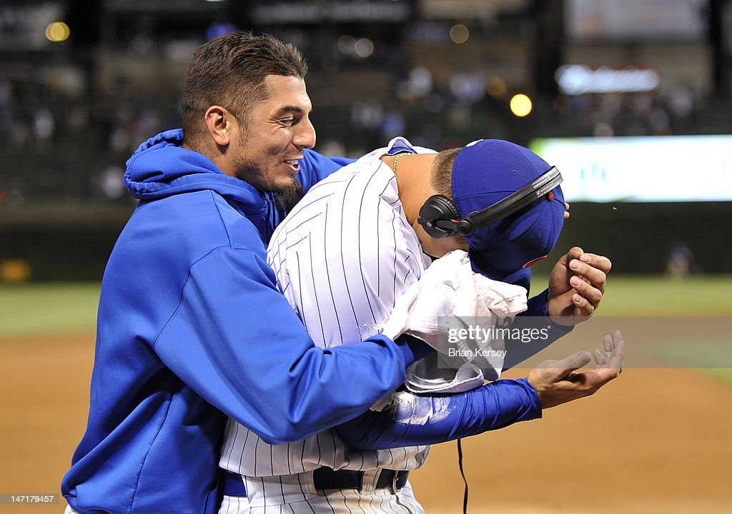 <a gi-track='captionPersonalityLinkClicked' href=/galleries/search?phrase=Matt+Garza&family=editorial&specificpeople=835829 ng-click='$event.stopPropagation()'>Matt Garza</a> #22 of the Chicago Cubs (L) rubs shaving cream in the face of teammate <a gi-track='captionPersonalityLinkClicked' href=/galleries/search?phrase=Anthony+Rizzo&family=editorial&specificpeople=7551494 ng-click='$event.stopPropagation()'>Anthony Rizzo</a> #44 as Rizzo was interviewed on television following the game against the New York Mets at Wrigley Field on June 26, 2012 in Chicago, Illinois. The Cubs defeated the Mets 5-3.