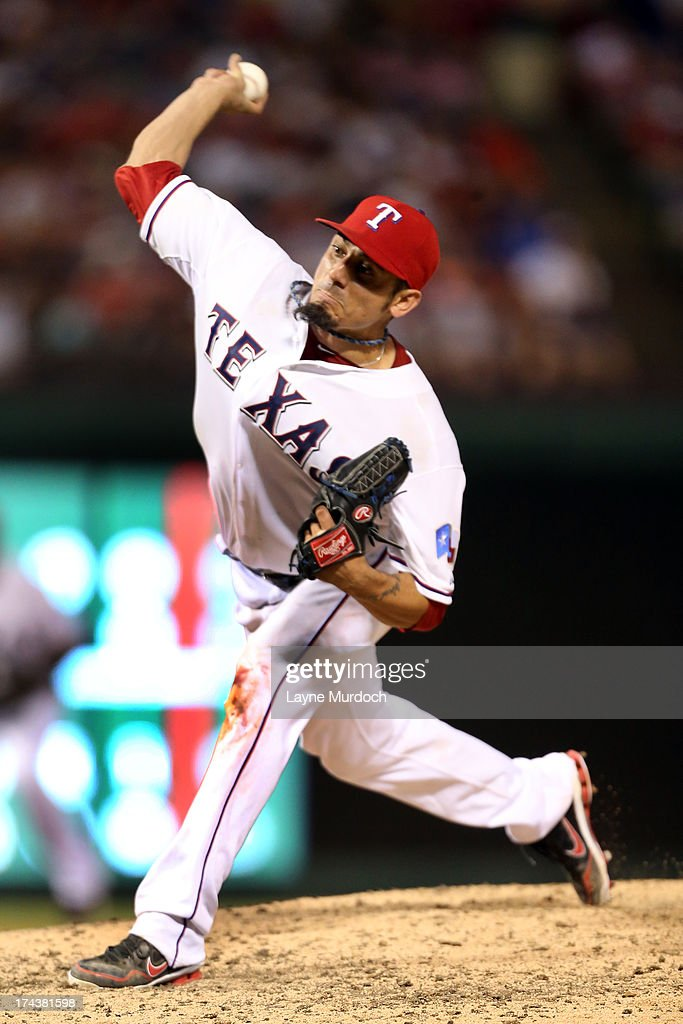 <a gi-track='captionPersonalityLinkClicked' href=/galleries/search?phrase=Matt+Garza&family=editorial&specificpeople=835829 ng-click='$event.stopPropagation()'>Matt Garza</a> #22, starting pitcher for the Texas Rangers pitches against the New York Yankees on July 24, 2013 at the Rangers Ballpark in Arlington in Arlington, Texas.