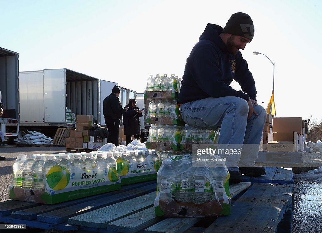 Matt Gassert takes a break at a food distribution site run by the Town of Hempstead in cooperation with FEMA at Oceanside Park during in the aftermath of Superstorm Sandy on November 9, 2012 in Merrick, New York. New York Gov. Andrew M. Cuomo has said that the economic loss and damage to homes and businesses caused by Sandy could total $33 billion in New York, according to published reports.