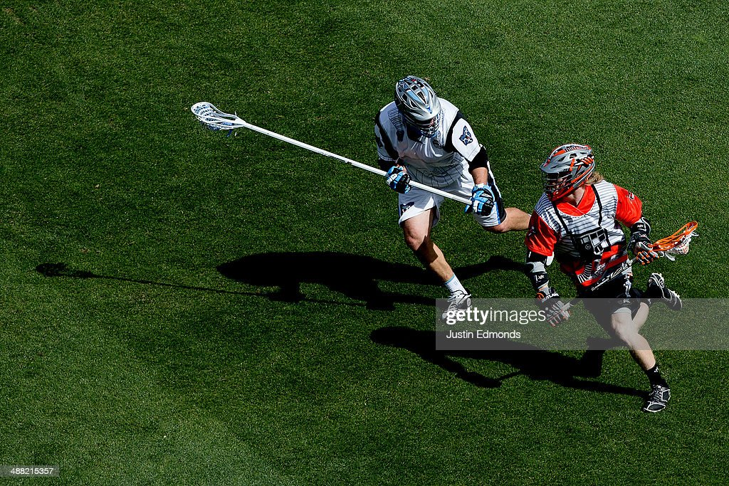 Matt Gibson #33 of the Denver Outlaws runs with the ball while being defended by <a gi-track='captionPersonalityLinkClicked' href=/galleries/search?phrase=Greg+Bice&family=editorial&specificpeople=7620903 ng-click='$event.stopPropagation()'>Greg Bice</a> #44 of the Ohio Machine during the second quarter at Sports Authority Field at Mile High on May 4, 2014 in Denver, Colorado. The teams wore Star Wars themed jerseys in honor of 'May-The-4th-Be-With-You' day.
