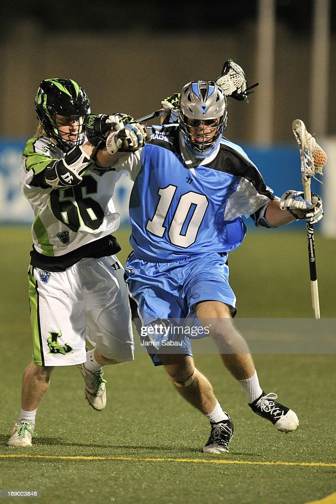 Matt Gibson #66 of the New York Lizards defends against Eric O'Brien #10 of the Ohio Machine in the third period on May 18, 2013 at Selby Stadium in Delaware, Ohio. New York defeated Ohio 14-8.