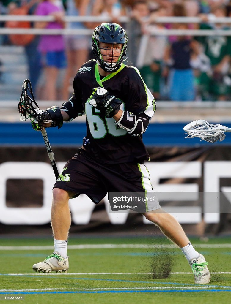 Matt Gibson #66 of the New York Lizards in action against the Charlotte Hounds during their Major League Lacrosse game at Shuart Stadium on May 31, 2013 in Uniondale, New York. The Hounds defeated the Lizards 14-12.