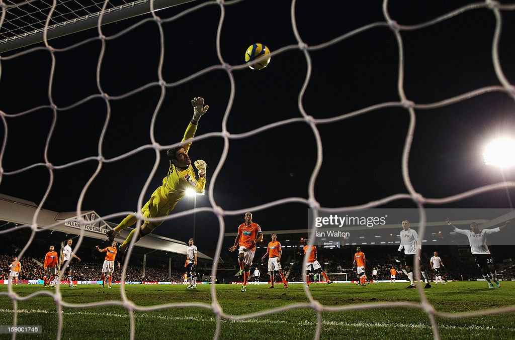 Matt Gilks the Blackpool goalkeeper fails to save the shot of Giorgos Karagounis (unseen) of Fulham to equalise during the FA Cup with Budweiser Third Round match between Fulham and Blackpool at Craven Cottage on January 5, 2013 in London, England.