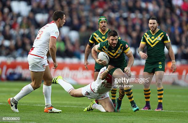 Matt Gillett of Australia is tackled by Josh Hodgson of England during the Four Nations match between the England and Australian Kangaroos at Olympic...