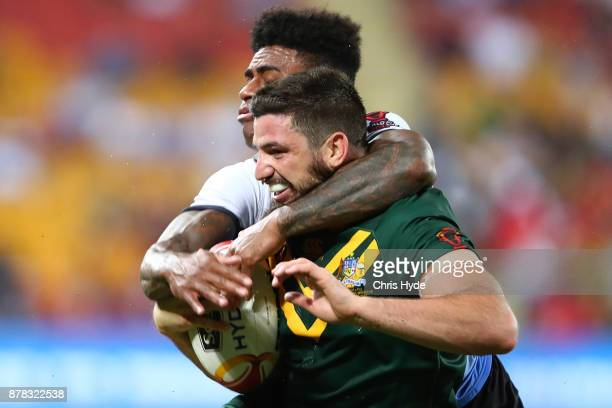Matt Gillett of Australia is tackled by Kevin Naiqama of Fiji during the 2017 Rugby League World Cup Semi Final match between the Australian...