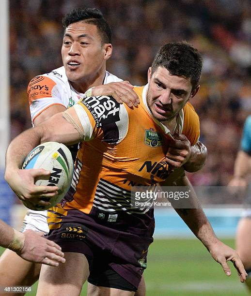 Matt Gillett of the Broncos attempts to break free from the defence during the round 19 NRL match between the Brisbane Broncos and the Wests Tigers...