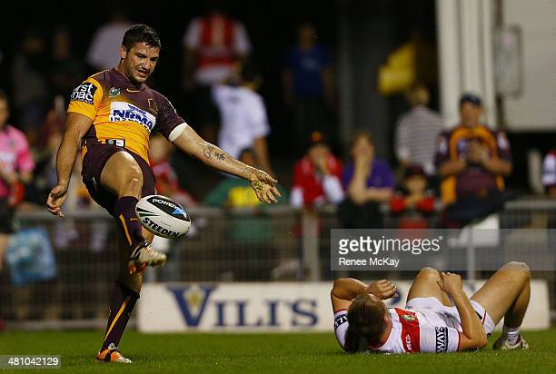 Matt Gillett of the Broncos celebrates his try as Brett Morris lays on the ground during the round four NRL match between the St George Illawarra...