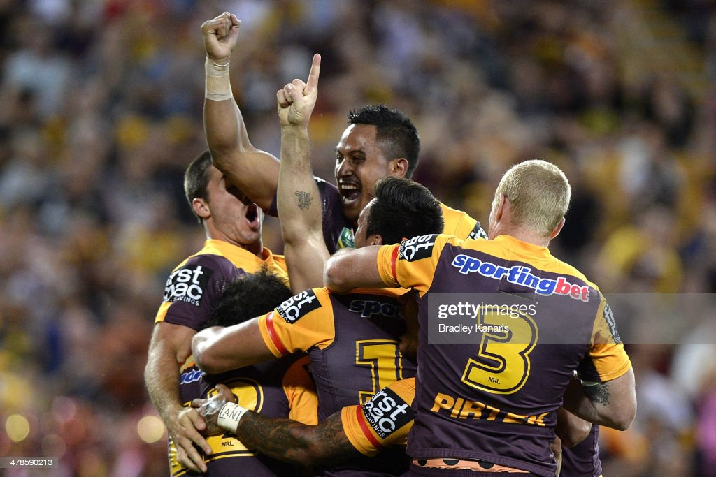 Matt Gillett of the Broncos celebrates with team mates after scoring a try during the round two NRL match between the Brisbane Broncos and the North Queensland Cowboys at Suncorp Stadium on March 14, 2014 in Brisbane, Australia.
