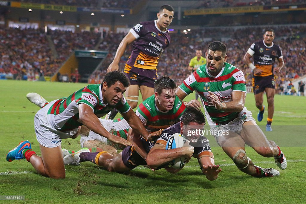 Matt Gillett of the Broncos dives to score a try during the round one NRL match between the Brisbane Broncos and the South Sydney Rabbitohs at Suncorp Stadium on March 5, 2015 in Brisbane, Australia.