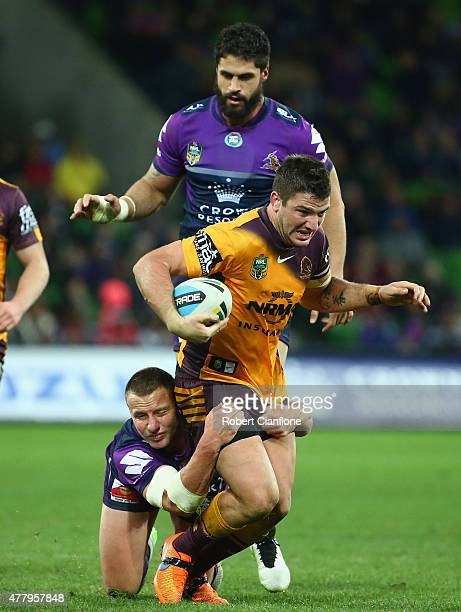 Matt Gillett of the Broncos is challenged by Blake Green of the Storm during the round 15 NRL match between the Melbourne Storm and the Brisbane...