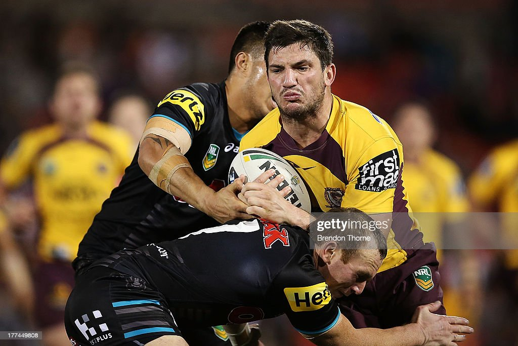 Matt Gillett of the Broncos is tackled by the Panthers defence during the round 24 NRL match between the Penrith Panthers and the Brisbane Broncos at Centrebet Stadium on August 23, 2013 in Sydney, Australia.