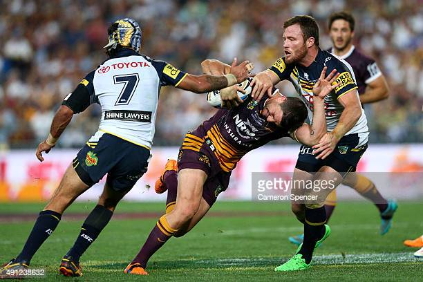 Matt Gillett of the Broncos is tackled during the 2015 NRL Grand Final match between the Brisbane Broncos and the North Queensland Cowboys at ANZ...