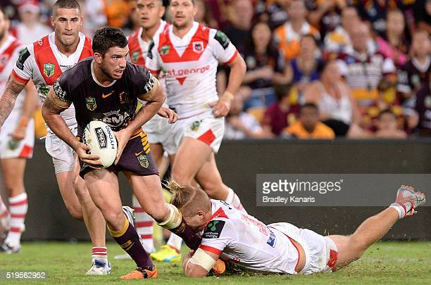 Matt Gillett of the Broncos looks to offload during the round six NRL match between the Brisbane Broncos and the St George Illawarra Dragons at...