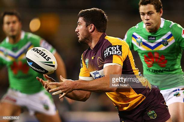 Matt Gillett of the Broncos offloads support during the round 13 NRL match between the Canberra Raiders and the Brisbane Broncos at GIO Stadium on...