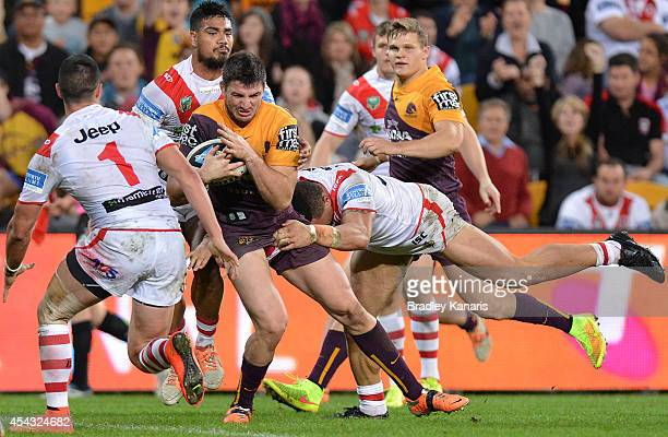 Matt Gillett of the Broncos pushes through the defence before going on to score a try during the round 25 NRL match between the Brisbane Broncos and...