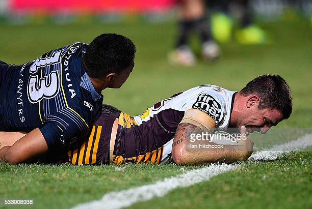 Matt Gillett of the Broncos scores a try during the round 11 NRL match between the North Queensland Cowboys and the Brisbane Bronocs at 1300SMILES...