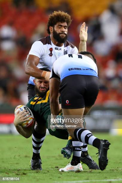 Matt Gillett of the Kangaroos is tackled during the 2017 Rugby League World Cup Semi Final match between the Australian Kangaroos and Fiji at Suncorp...