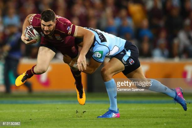 Matt Gillett of the Maroons is tackled by Jarryd Hayne of the Blues during game three of the State Of Origin series between the Queensland Maroons...