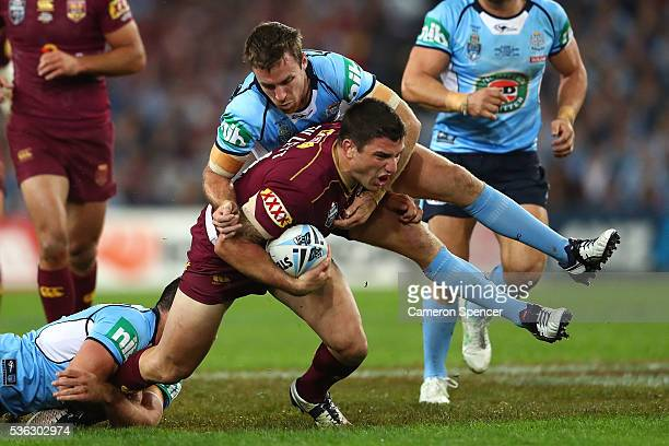 Matt Gillett of the Maroons is tackled during game one of the State Of Origin series between the New South Wales Blues and the Queensland Maroons at...
