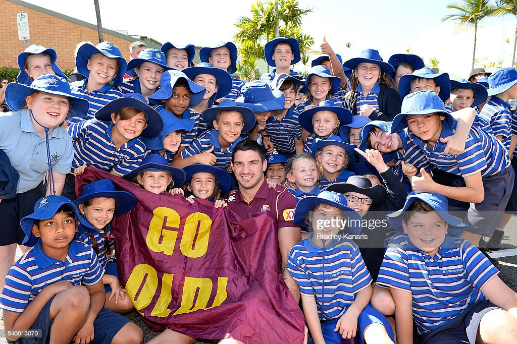 Matt Gillett poses with a group of young fans during a Queensland Maroons State of Origin Fan Day on June 14, 2016 in Gladstone, Australia.