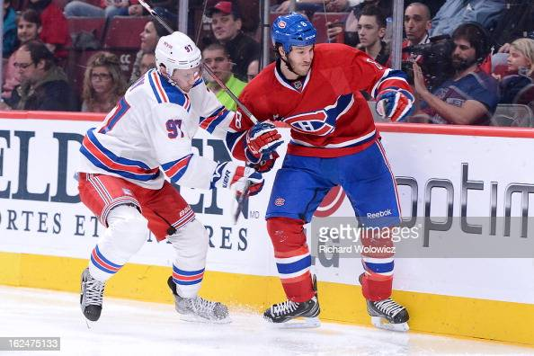 Matt Gilroy of the New York Rangers checks Brandon Prust of the Montreal Canadiens during the NHL game at the Bell Centre on February 23 2013 in...