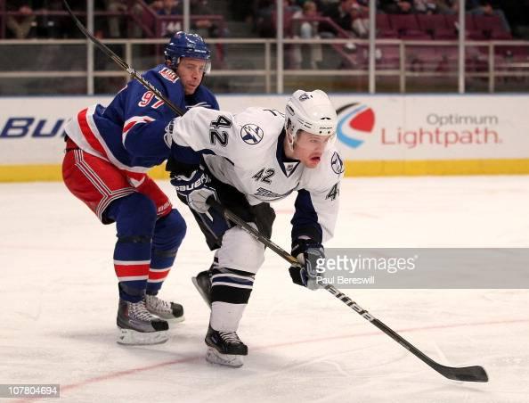 Matt Gilroy of the New York Rangers checks Dana Tyrell of the Tampa Bay Lightning during an NHL hockey game at Madison Square Garden on December 23...
