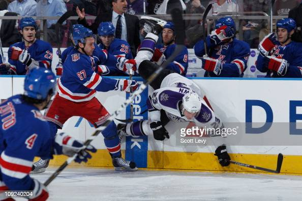 Matt Gilroy of the New York Rangers checks Dustin Brown of the Los Angeles Kings into the boards in the first period on February 17 2011 at Madison...