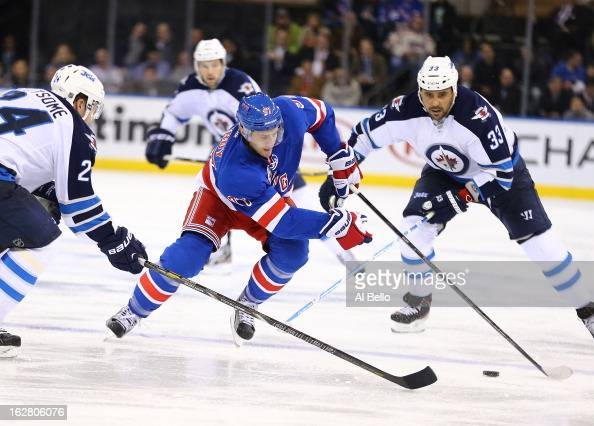 Matt Gilroy of the New York Rangers in action against Grant Clitsome of the Winnipeg Jets during their game at Madison Square Garden on February 26...