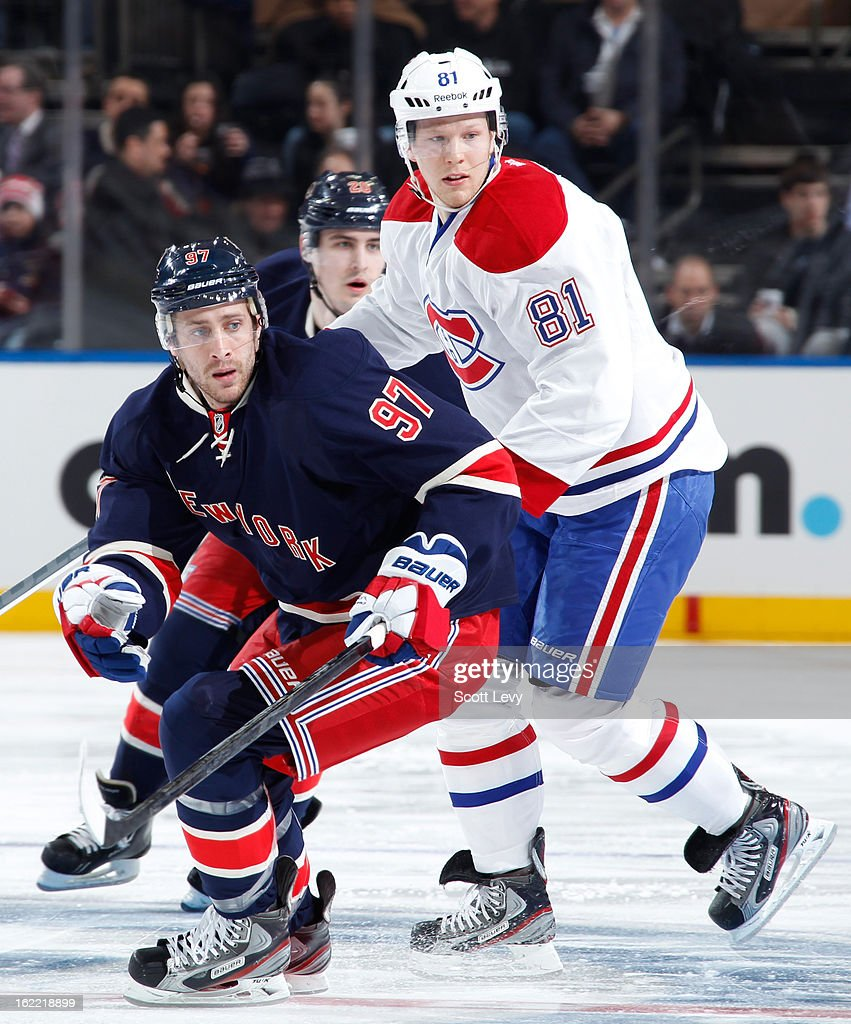 <a gi-track='captionPersonalityLinkClicked' href=/galleries/search?phrase=Matt+Gilroy&family=editorial&specificpeople=817917 ng-click='$event.stopPropagation()'>Matt Gilroy</a> #97 of the New York Rangers skates against <a gi-track='captionPersonalityLinkClicked' href=/galleries/search?phrase=Lars+Eller&family=editorial&specificpeople=4324947 ng-click='$event.stopPropagation()'>Lars Eller</a> #81 of the Montreal Canadiens at Madison Square Garden on February 19, 2013 in New York City.