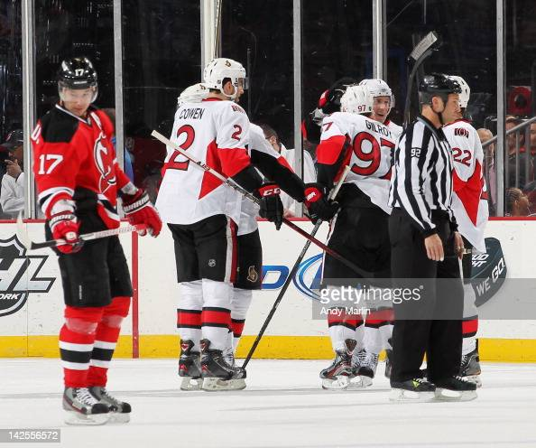 Matt Gilroy of the Ottawa Senators is congratulated by his teammates after scoring a firstperiod goal as Ilya Kovalchuk of the New Jersey Devils...