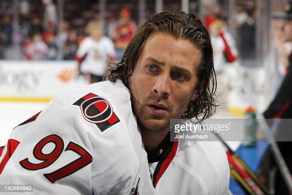 Matt Gilroy of the Ottawa Senators stretches along the boards prior to the game against the Florida Panthers on March 4 2012 at the BankAtlantic...