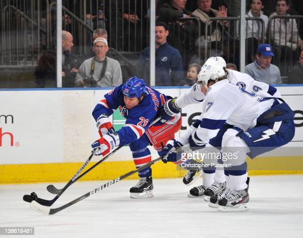 Matt Gilroy of the Tampa Bay Lightning and Ruslan Fedotenko of the New York Rangers reach for the puck during the game on February 9 2012 at Madison...