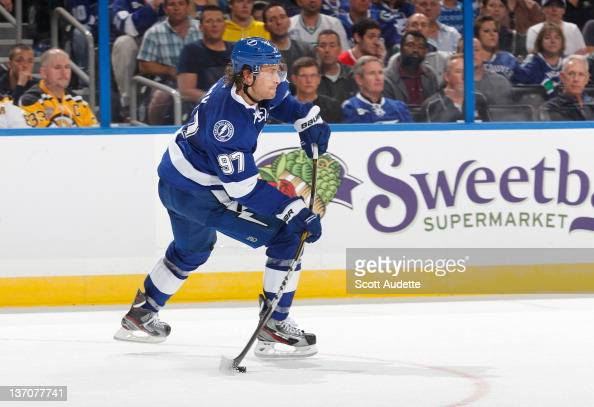 Matt Gilroy of the Tampa Bay Lightning passes the puck against the Vancouver Canucks at the Tampa Bay Times Forum on January 10 2012 in Tampa Florida