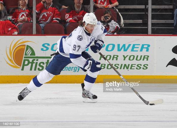 Matt Gilroy of the Tampa Bay Lightning plays the puck against the New Jersey Devils during the game at the Prudential Center on February 26 2012 in...