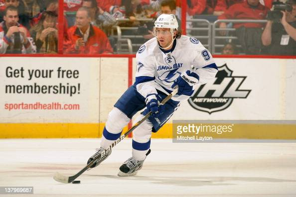 Matt Gilroy of the Tampa Bay Lightning skates with the puck during a NHL hockey game against the Washington Capitals on January 13 2012 at the...